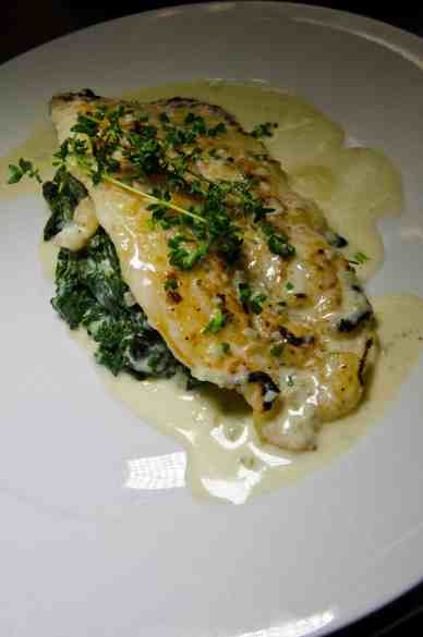 Pan-seared sole filet with champagne & dill cream, wilted spinach.